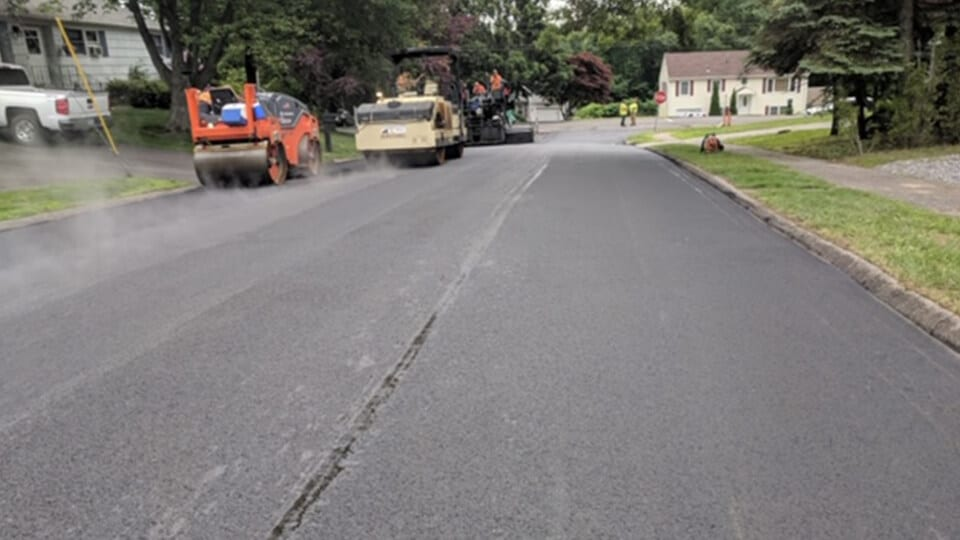 new pavement with steam roller
